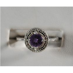 .925 PURPLE STONE RING SURROUNDED BY A MODERN HALO WHICH LOOKS LIKE DIAMONDS