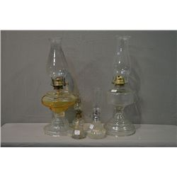 Two large vintage oil lamps with hurricanes, and two small oil lamps with hurricanes