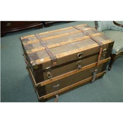 Antique canvas wrapped steamer trunk with oak and brass bindings and leather straps