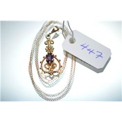 Lady's 14kt yellow gold pendant set with amethyst gemstone on a 14kt yellow gold chain