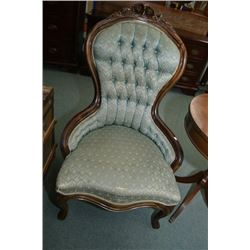 Victorian style button tufted upholstered parlour chair with carved floral decoration