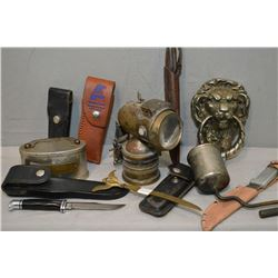 Selection of collectibles including small tin bank, lion's head door knocker, sheathed knives includ