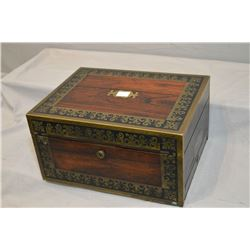 Antique rosewood locking and fitted traveling case with ornate brass and ebony decoration including