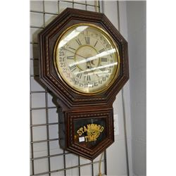 Vintage W.M.L Gilbert Clock Co. Winsted, Connecticut wood cased 31 day wall clock with visible pendu