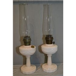 Pair of pink Lincoln Drape Aladdin kerosene mantle lamps with Aladdin chimneys