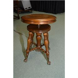 Adjustable vintage piano stool with cast and glass ball and claw feet