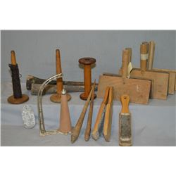 Collection of vintage treenware including wool carders, spools etc.