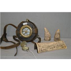 Three pieces of simulated scrimshaw, a WWI pocket watch style field compass and a Hardinge Bros. Wat