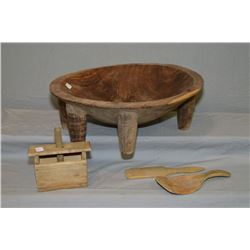 Large wooden mixing bowl, a butter pat and two wooden utensils