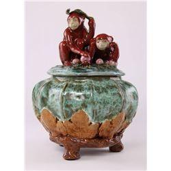 Cookie jar depicting two playful monkeys holding fruit