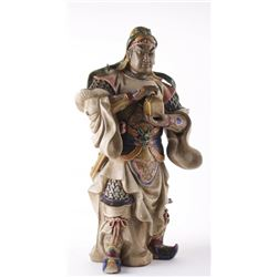 Chinese Warrior bearing a gift.  A polychrome ceramic