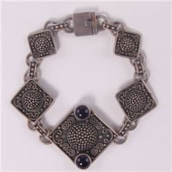 Indonesian sterling silver bracelet with purple stones,