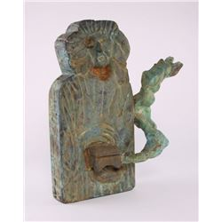 Contemporary wood carved sculpture with green patina.