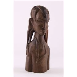 African carved ebony wood head Tribal wood carving of a