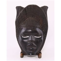 African mask carved from ebony wood.  SIZE: see