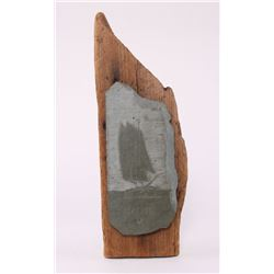 """Scrimshaw slate of a sailboat signed by artist """"Brot""""."""