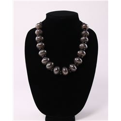 Peened silver and onyx beaded necklace with braided