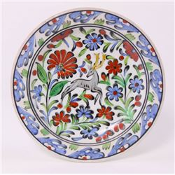"Hand-painted porcelain plate, marked ""Hand Made in"