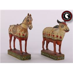 Two (2) Antique polychrome wood carved sculptures of a