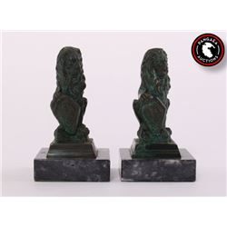 Two (2) patinated bronze Lion desktop
