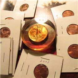"Group of various Lincoln Cents in 2"" x 2"" holders and a 1944 P World War II Silver Walking Liberty H"