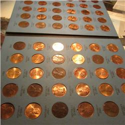 1975-2002 Set of Lincoln Cents in a Whitman Coin folder. A few are high grades. (61 pcs.).