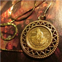 "1985 Englehard 1/10 oz. Gold Prospector in a frilly 14K Gold bezel with a 20"" 14K Gold Chain. Total"