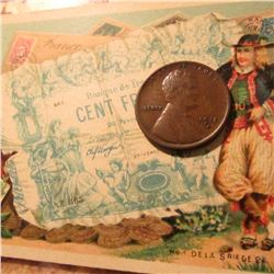 "1915 D Lincoln Cent in EF condition with an early advertising card from ""Fera's Confectionery and Re"