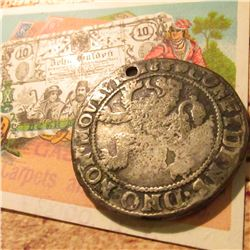 Weird appearing 1660 'Lion' Thaler, holed with an early advertising card from Gas Bros. Carpets and