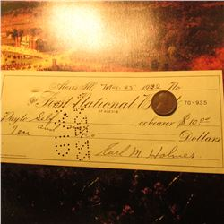 "Mar. 25, 1922 ""The First National Bank"" of Alexis, Ill. cancelled check and a 1922 D Lincoln Cent in"