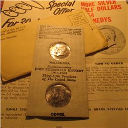 (2) 1964 P John f. Kennedy Silver Half Dollars with original Tidy House Advertising and holder.