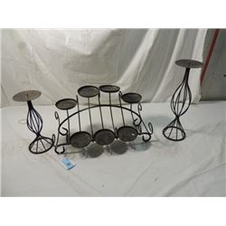 THREE BLACK WROUGHT IRON CANDLE HOLDERS