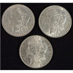 3 - AU MORGAN SILVER DOLLARS; 1879-O, 1882, 1888