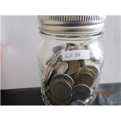 A jar of foreign coins
