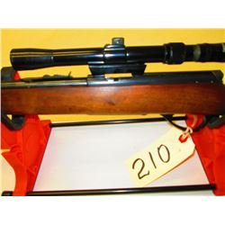 Marlin bolt action, tube fed with Tasco 3-7 scope