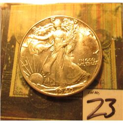1940 P Walking Liberty Half Dollar. Original toned AU+.