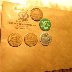 Five-Piece Set of Fort Dodge Creamery Co. Good For Tokens and an unaddressed Envelope with their ret