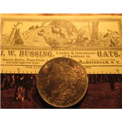 """J.W. Bussing, …Hats…Ladies' Furs… Amsterdam, N.Y."" Business Card & 1921 P Morgan Silver Dollar with"