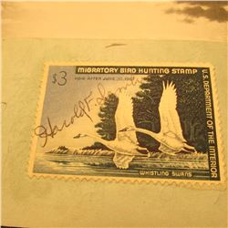RW33 Signed U.S. Department of the Interior Migratory Bird Hunting Stamp. Attached to paper.
