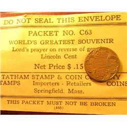 "1935 Lincoln Cent stamped with the Lord's Prayer, in a vintage envelope from the ""Tatham Stamp & Coi"