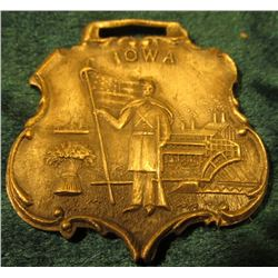 "Metal Watch Fob ""Iowa"". Depicts a Civil War Soldier holding a U.S. flag. Fob is shield shape. Circa."