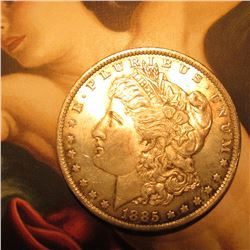 1885 O Morgan Silver Dollar. Lightly toned Brilliant Uncirculated.