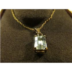 14K Gold Aquamarine Rectangular cut on a 14K Gold Chain. Weighs 1.61 grams. In original display box