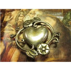"""J C Laire Sterling Silver .925""  Heart-shaped Pendant with floral scroll. Weighs 10.98 grams."