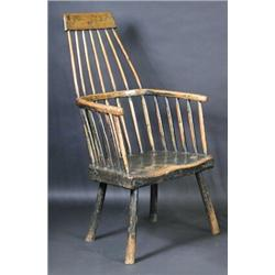 A 19th Century Ash And Elm Primitive Comb Back Windsor Chair, The Narrow  Top Rail Above A Spindle B.