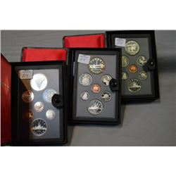 Three cased Canadian double dollar proof sets including 1982, 1984 and 1985