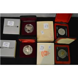 Four cased Canadian silver dollars including 1970 Manitoba, 1972, 1989 Sir Alexander MacKenzie and 1