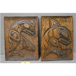 "Pair of 10"" X 8"" hand carved Haida plaques, both titled on verso ""Sea Monster"" and ""Killer Whale"" ca"