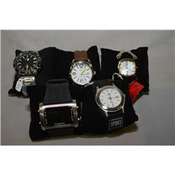 Selection of five brand new gents and ladies quartz wrist watches, retail pricing $49.00-$100.00 -al
