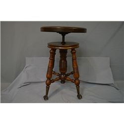 Antique adjustable piano stool with cast and glass ball and claw feet